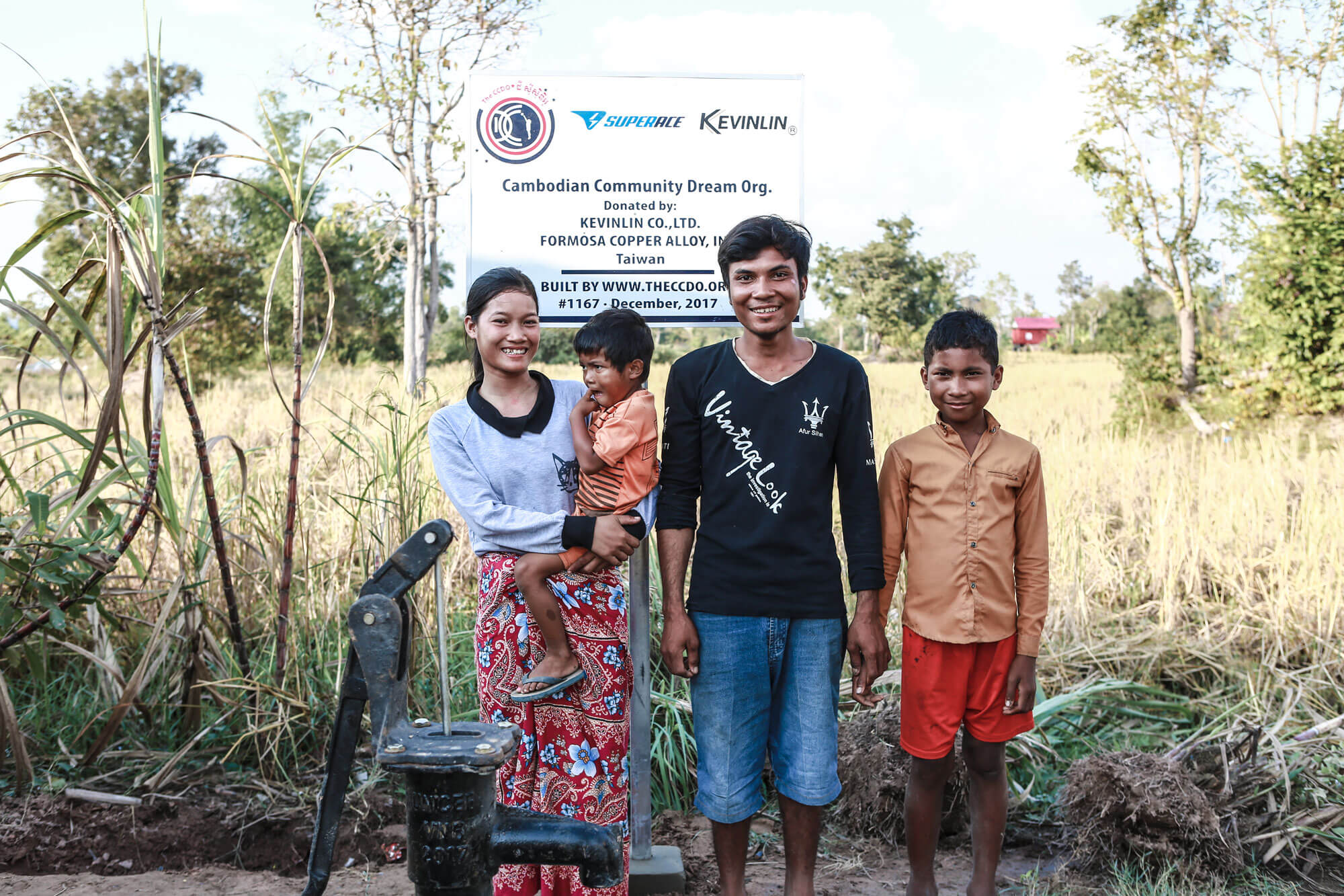 The happy family supported with a water well